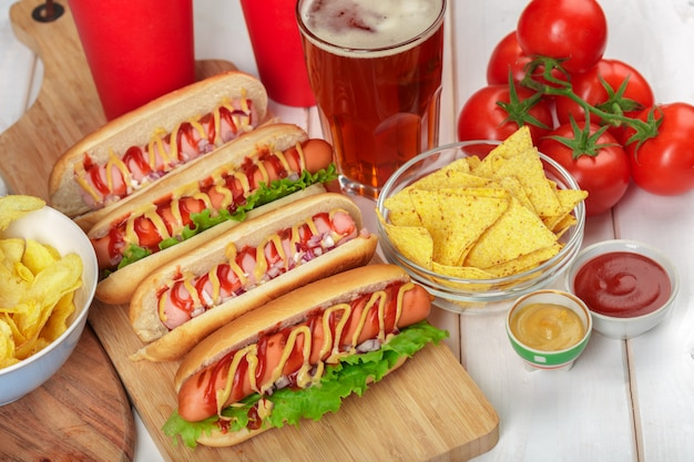 Hot dogs on wooden surface