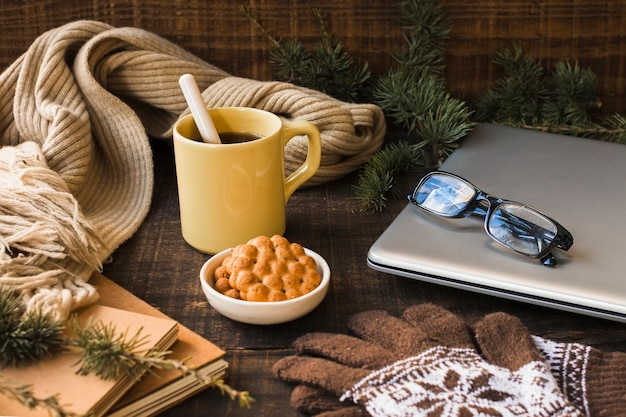 Hot drink near warm accessories and laptop