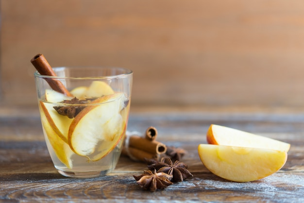 Hot drink with apples for autumn or winter holidays.