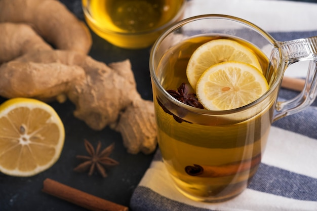 Hot drink with honey, lemon and ginger for cough remedy. autumn hot drink