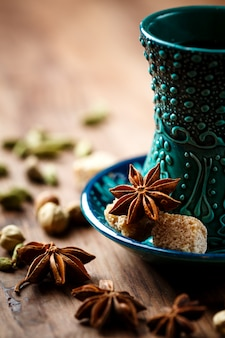 Hot drink with spices in authentic cup