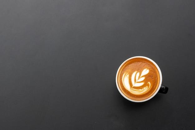 Hot espresso on black table