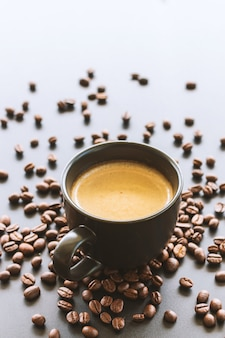 Hot espresso and coffee beans