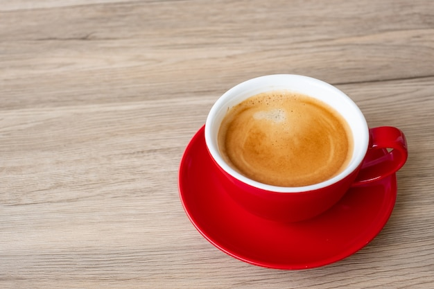 Hot espresso coffee on table, red coffee cup in cafe or home.top view with blank copy space for your text.