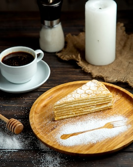 Hot espresso with honey cake on the table