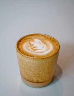 Hot flat white with art design on white background
