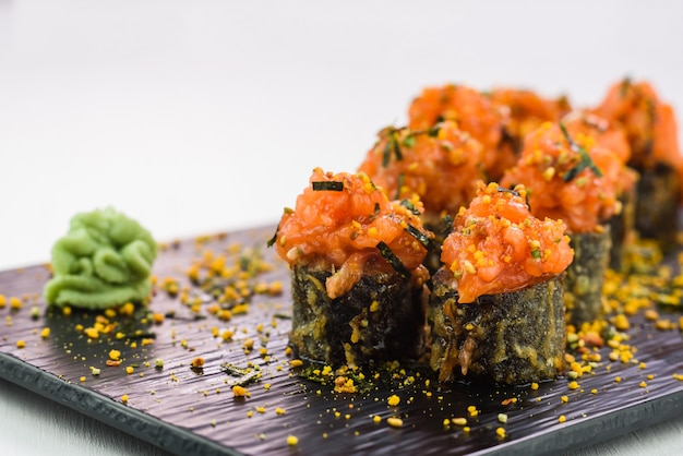 Hot and fried sushi and rolls with seafood, vegetables, cream cheese