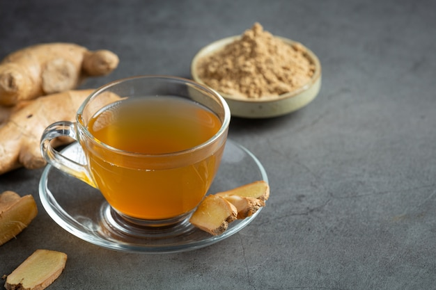 Hot ginger tea on table