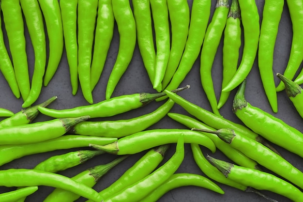 Hot green pepper. chilean pepper on a black background.