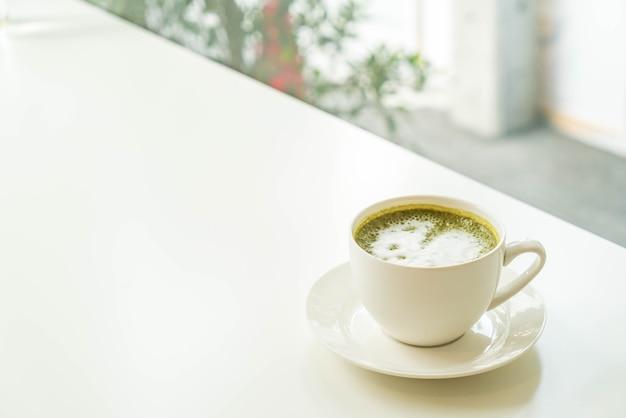 Hot green tea latte cup