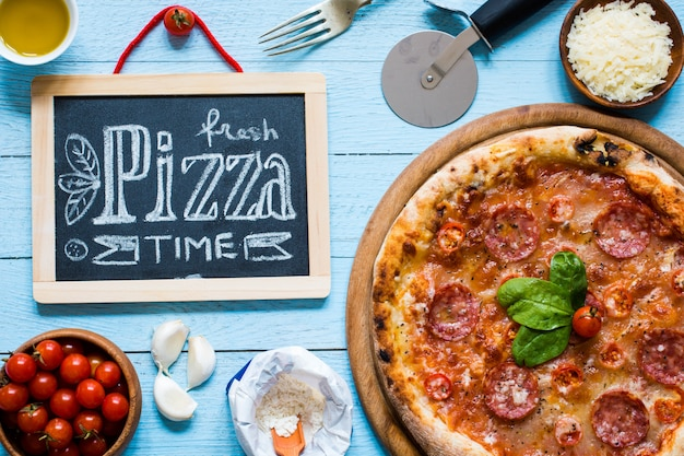 Hot italian pizza on a rustic wooden table.