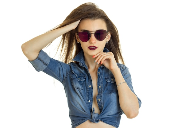Hot lady in jeans jacket without bra in sunglasses isolated on white