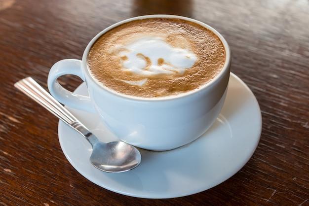 Hot latte art coffee in coffee shop