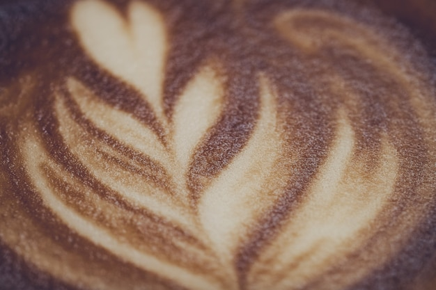 Hot latte art coffee on wood table, relax time