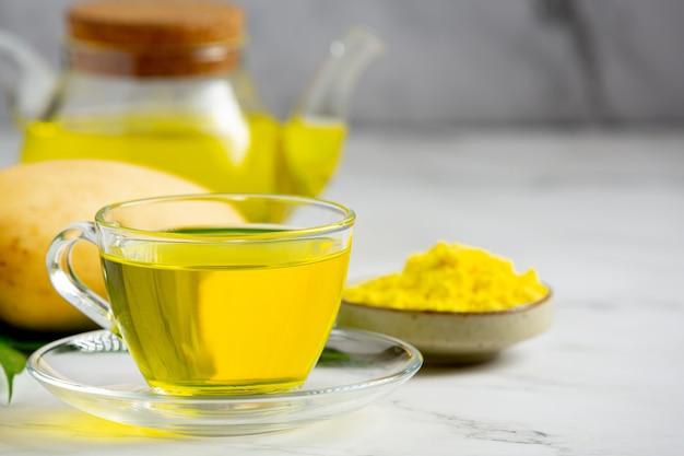 Hot mango tea on table