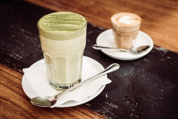 Hot matcha green tea latte cup