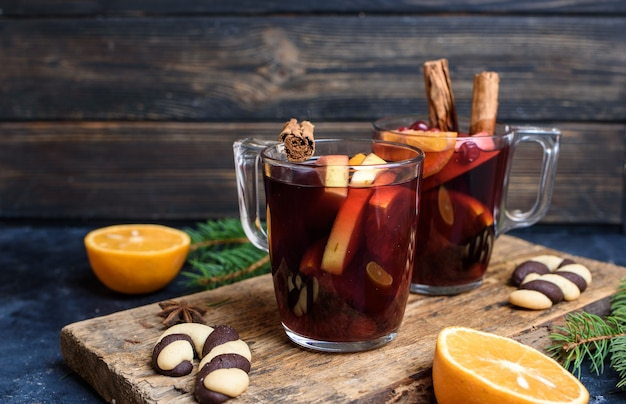 Hot mulled wine for winter and christmas on wooden table