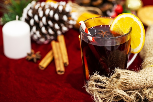 Hot mulled wine with spices on christmas background