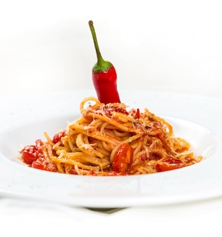 Hot pasta with cheese and tomatos