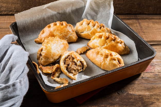 Hot pasties from butter enriched puff pastry