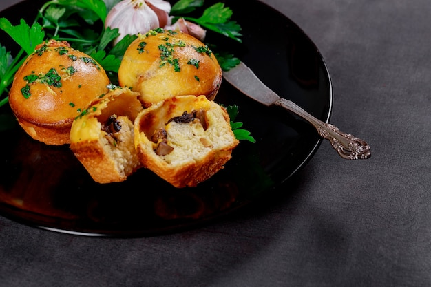 Hot pies with mushrooms and garlic on wooden gray boards