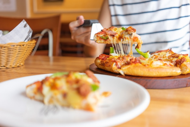 Hot pizza dip tray of pizza toppings include ham, pork, paprika and vegetables, pizza,
