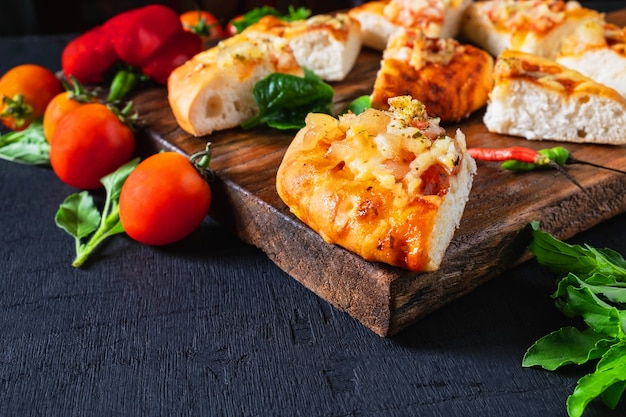 Hot pizza on wooden tray for pizza