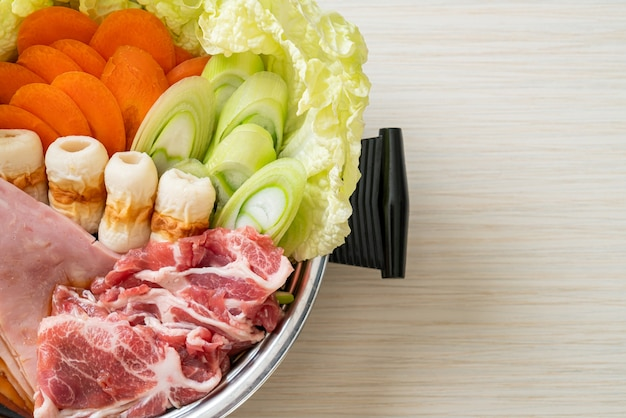 Hot pot with meat raw and vegetable for soup