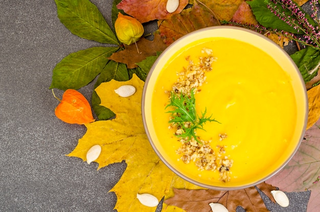 Hot pumpkin soup of dried autumn leaves.