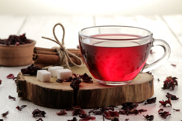 Hot red karkade tea in  cups  on a white wooden table
