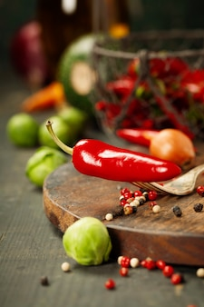 Hot red pepper and ingredients for cooking