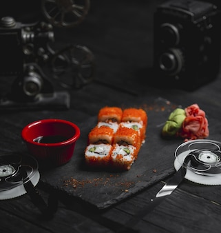 Hot rolls with red caviar and sauce