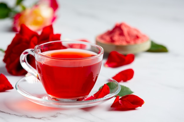 Hot rose tea on table
