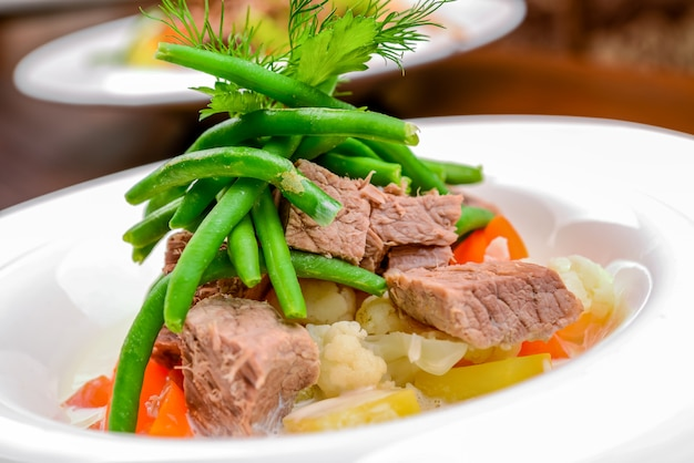 Hot salad with meat, vegetables and beans