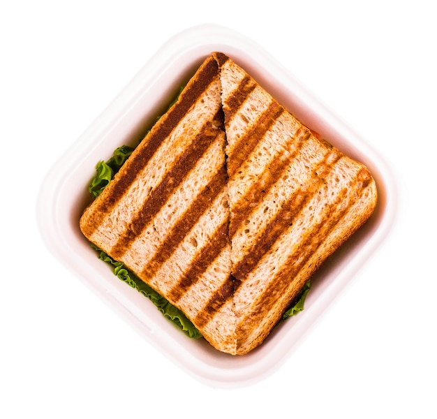 Hot sandwich in a plastic bowl isolated. view from above