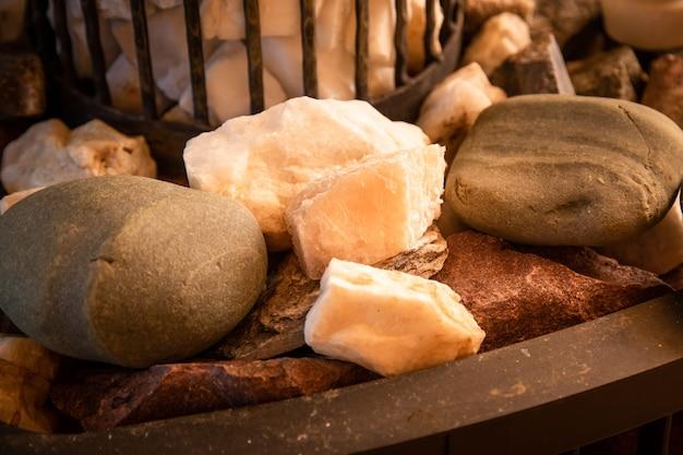 Hot sauna stones. closeup photo of granite rocks, white, brown and gray.