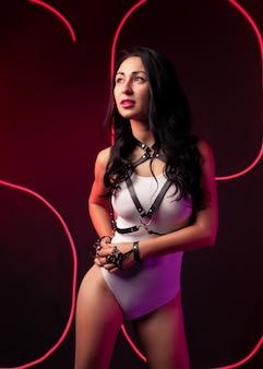 Hot sexy girl neon light dance night club leather harness dressed white night-club