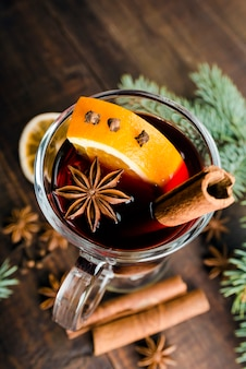 Hot spiced mulled wine garnished with orange
