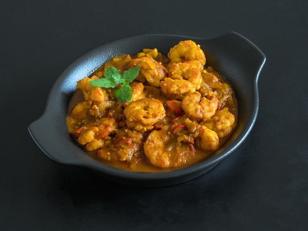 Hot spicy prawn curry. shrimp in curry sauce in the pan