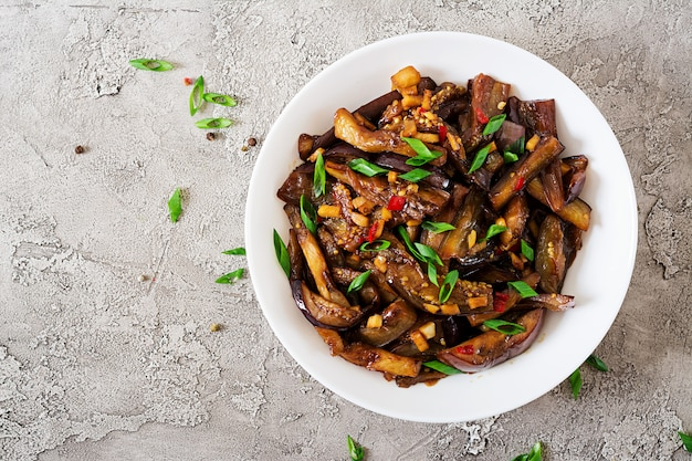 Hot spicy stew eggplant in korean style with green onion. aubergine saute.