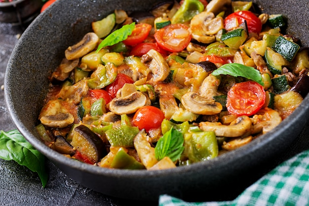 Hot spicy stew eggplant, sweet pepper, tomato, zucchini and mushrooms.