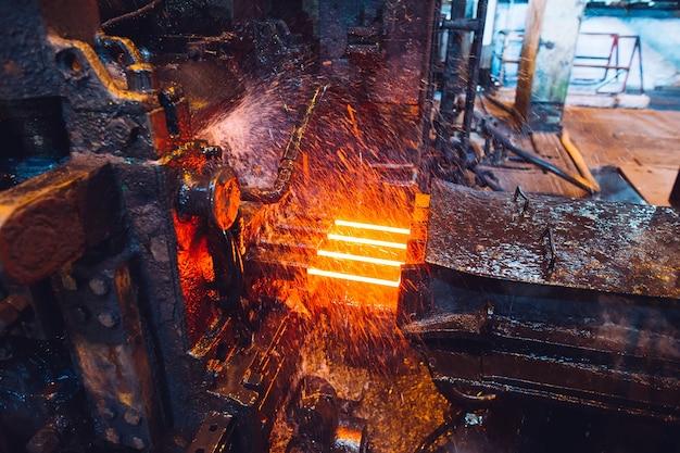 Hot steel on conveyor in steel mill