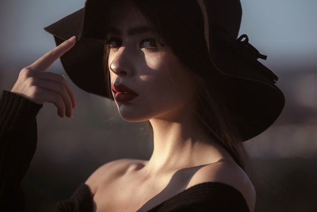 Hot summer girl beauty lady wear fashion hat romantic model woman with style fashion accessory closeup portrait of girl with sensual face light and shadow