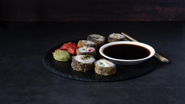 Hot sushi roll with salmon, eel, tuna, avocado, royal prawn, cream cheese philadelphia, caviar tobica, chuka.