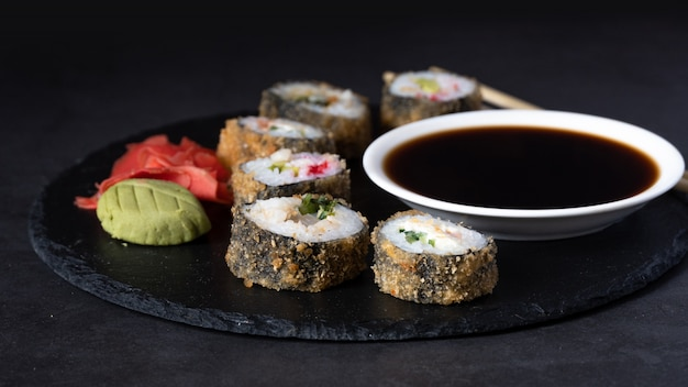 Hot sushi roll with sauce