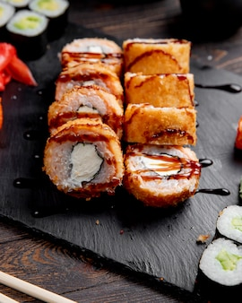 Hot sushi rolls with sauce and ginger