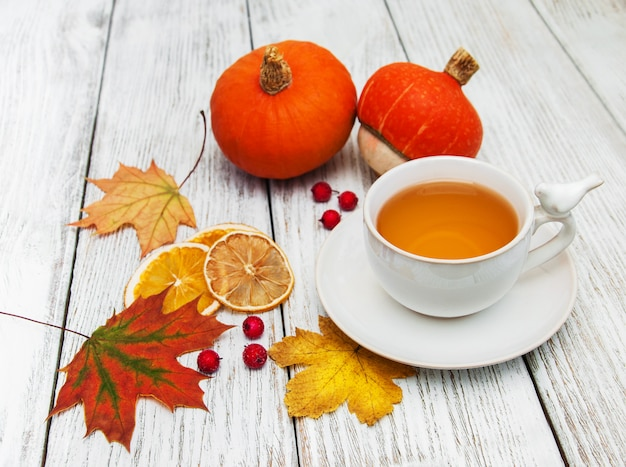 Hot tea and autumn leaves