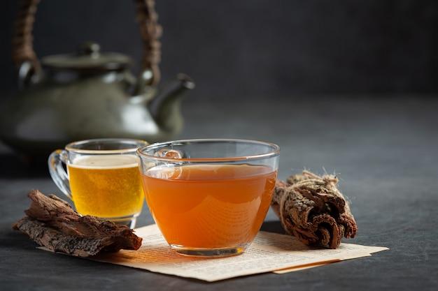 Hot tea and bark on table