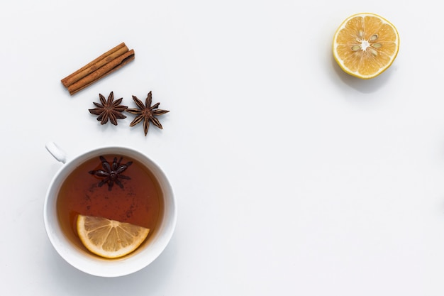 Hot tea cup with various ingredients