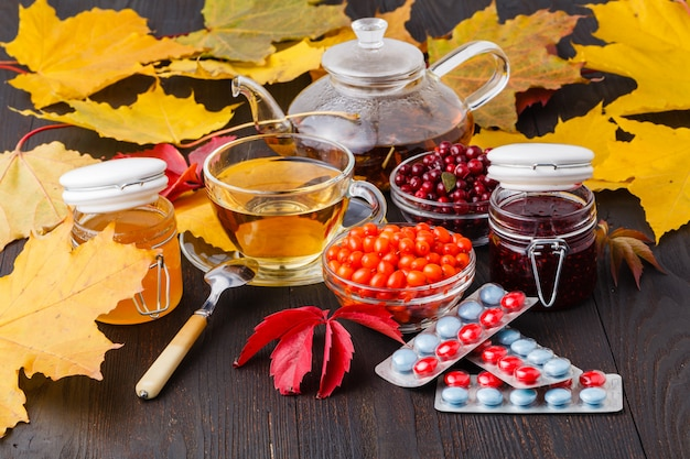 Hot tea with berry, treatment of folk remedies, tablets, sea buckthorn, alternative medicine, complementary medicine